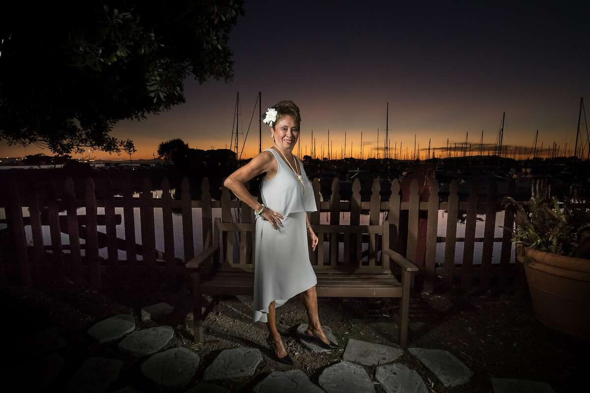 Retiring Claudette Lum, a hostess for Trader Vic's since 1960, pose outside the restaurant on Friday, Oct. 6, 2017 in Emeryville, CA.