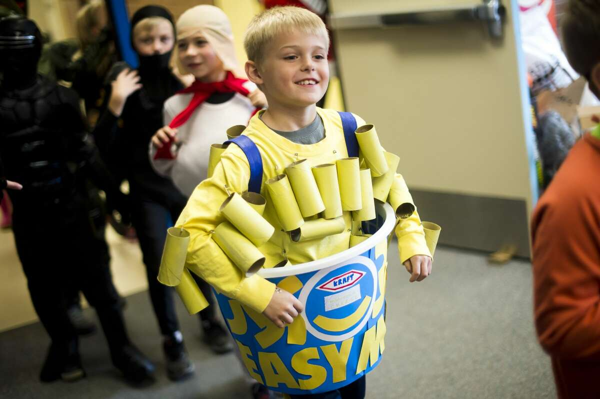 Students and faculty at Adams Elementary take a break from class to parade through the halls in their Halloween costumes on Tuesday, Oct. 31, 2017. (Katy Kildee/kkildee@mdn.net)