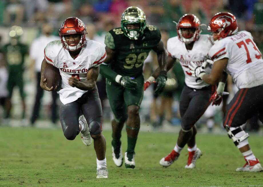 Houston quarterback D'Eriq King (4) scores against South Florida during the second half of an NCAA college football game Saturday, Oct. 28, 2017, in Tampa, Fla. Houston upset South Florida 28-24. (AP Photo/Chris O'Meara) Photo: Chris O'Meara, STF / Copyright 2017 The Associated Press. All rights reserved.