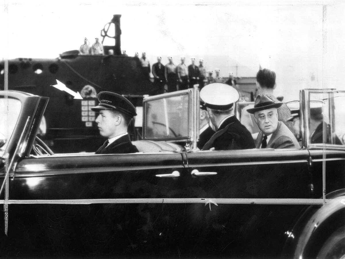 President Franklin D. Roosevelt at Mare Island Naval Base in Vallejo, September 24, 1942. The arrow points to nine rising star flags on the submarine's conning tower which indicates the number of Japanese ships it had sunk. Associated Press Wirephoto from the U.S. Navy, Photo ran 10/2/1942