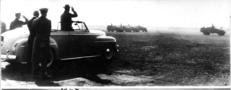 President Franklin D. Roosevelt salutes the troops at Fort Lewis, Wash., on Sept. 22, 1942.