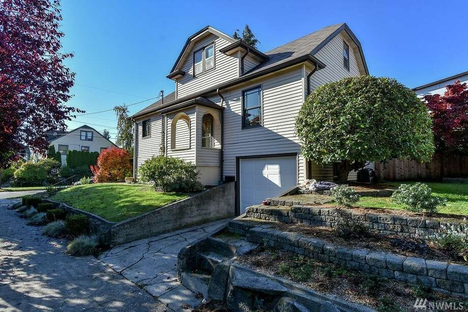 This 1928 Craftsman comes with era details complemented by well-chosen upgrades: Oak floors, coved ceilings and picture rail, without sacrificing new kitchen cabinets and electrical update.The location is 602 N.W. 79th St., listed for $645,000. See the full listing below. Photo: Listing Provided Courtesy Of Tamara Marson, Windermere Real Estate Midtown