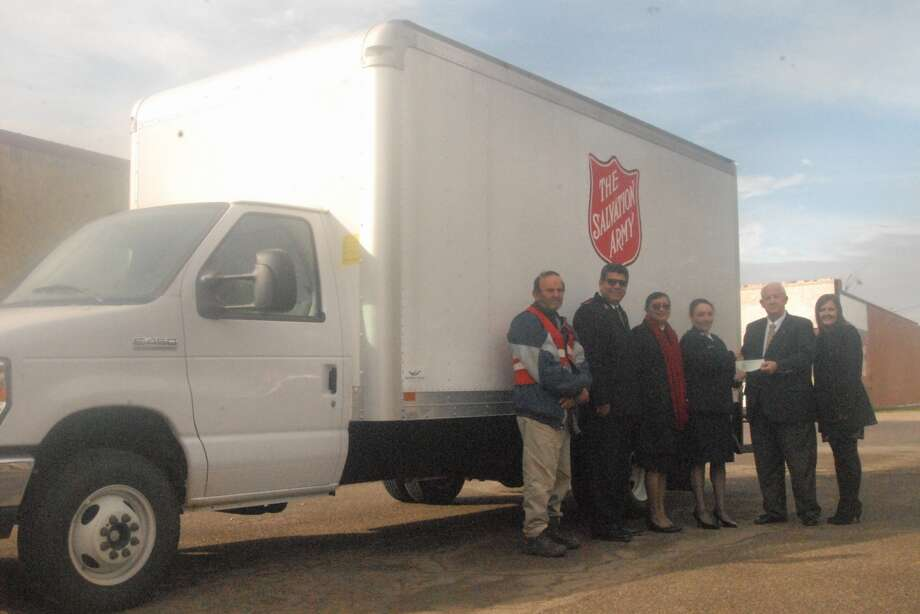The Salvation Army Family Store in Plainview has a new box truck thanks to a gift from the James and Eva Mayer Foundation. It replaces an old truck that has been in service for the past 17 years. On hand for the grant presentation are Salvation Army driver Johnie Loyd (left), Capts. Nathanael G. Doria and Lucila Doria, Lubbock Corps officers; Michelle Rutherford, local agency director; Mayer Foundation Trustee David Wilder; and Kimberly Lueb of Lubbock, Salvation Army regional representative.