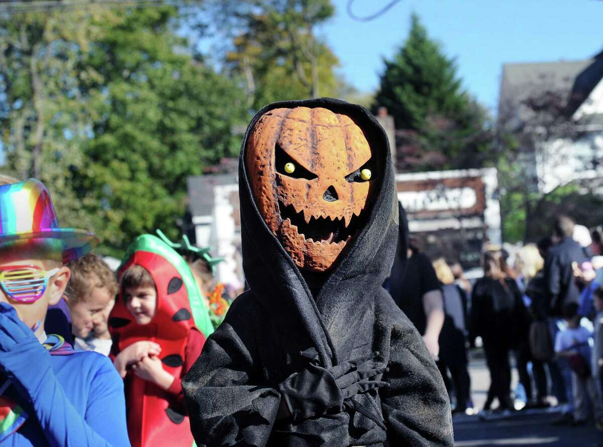 Old Greenwich School third-grader Linden Bechtel wore a Jack-O'-Lantern costume while marching in the Halloween parade at the school and down Sound Beach Avenue in Old Greenwich, Conn., Tuesday, Oct. 31, 2017.