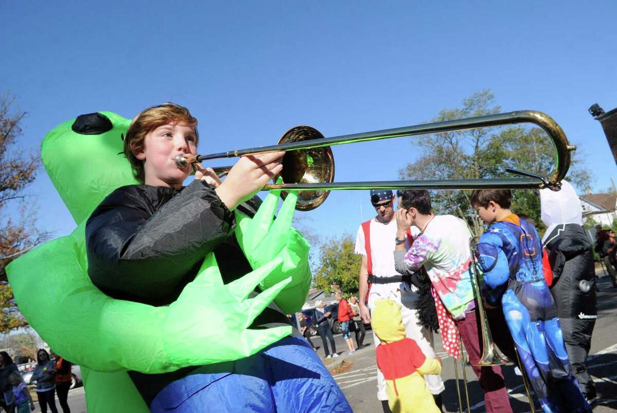 Old Greenwich School Halloween band member and fifth grader James Markline, 10, played the trombone during the annual Halloween parade at the school and down Sound Beach Avenue in Old Greenwich, Conn., Tuesday, Oct. 31, 2017.