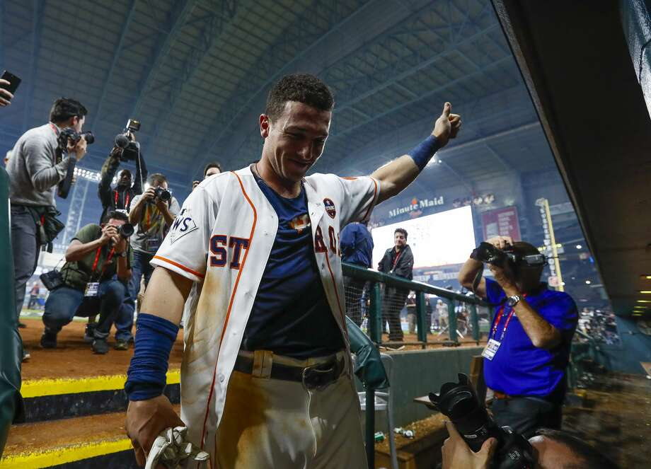 Houston Astros third baseman Alex Bregman (2) enters the Astros dugout after hitting a walk off single that drove in pinch runner Derek Fisher and gave the Astros a 13-12 win over the Los Angeles Dodgers in the tenth inning of Game 5 of the World Series at Minute Maid Park on Monday, Oct. 30, 2017, in Houston. Photo: Karen Warren/Houston Chronicle