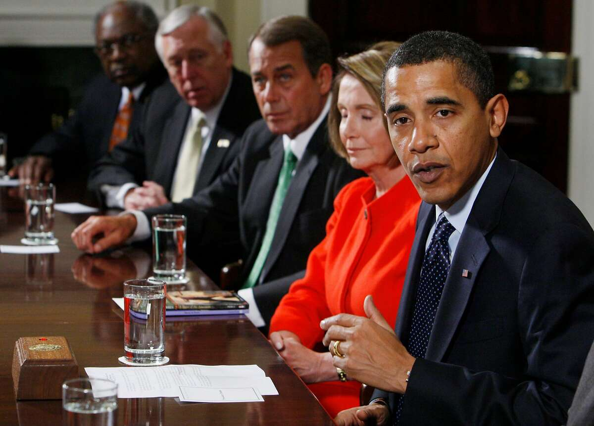 President Barack Obama speaks to reporters during a meeting about the economy with Congressional leaders, Friday, Jan. 23, 2209, in the Roosevelt Room of the White House in Washington. From left are, Majority Whip Jim Clyburn of S.C.; House Majority Leader Steny Hoyer of Md.; House Minority Leader John Boehner of Ohio; House Speaker Nancy Pelosi of California; and the president. (AP Photo/Charles Dharapak)