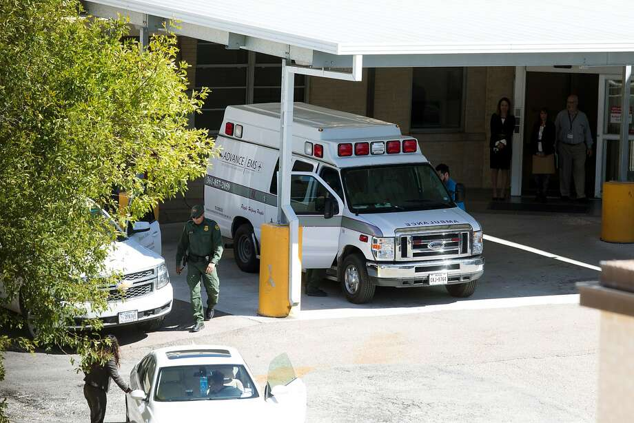 In this Wednesday, Oct. 25, 2017 photo, a United States Customs and Border Protection agent walks away after helping to place an undocumented 10-year-old girl with cerebral palsy in the back of an ambulance to transfer her from Driscoll Children's Hospital in Corpus Christi, Texas, to a children's facility in San Antonio for emergency gallbladder surgery.  Immigration advocates are protesting the case and say Border Patrol should show more discretion in the cases of sick children who are in the U.S. illegally but need medical treatment. (Courtney Sacco/Corpus Christi Caller-Times via AP) Photo: Courtney Sacco, Associated Press