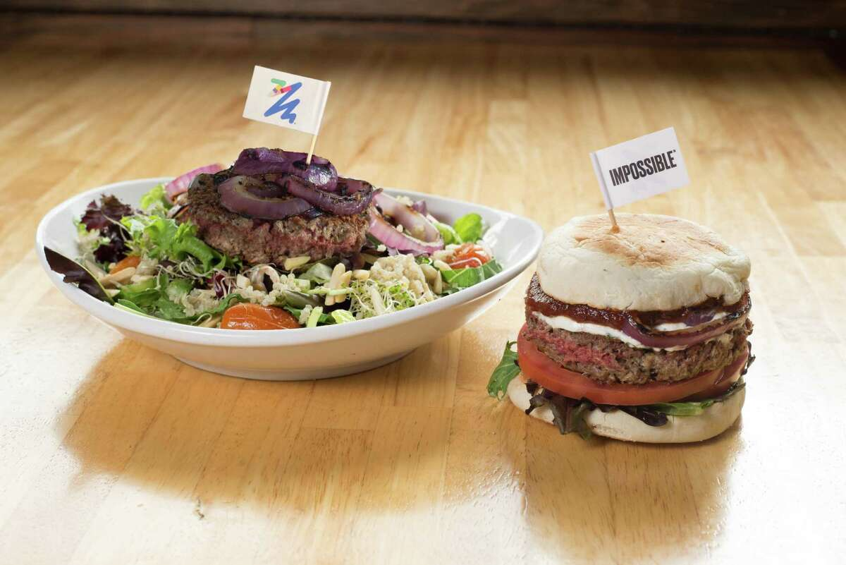 The Counter burger restaurants has added the Impossible Burger to its menu offerings. The Impossible Burger is a plant-based meatless burger that cooks and tastes like ground beef. Shown: the Impossible Salad, and the Counter's signature Impossible burger.