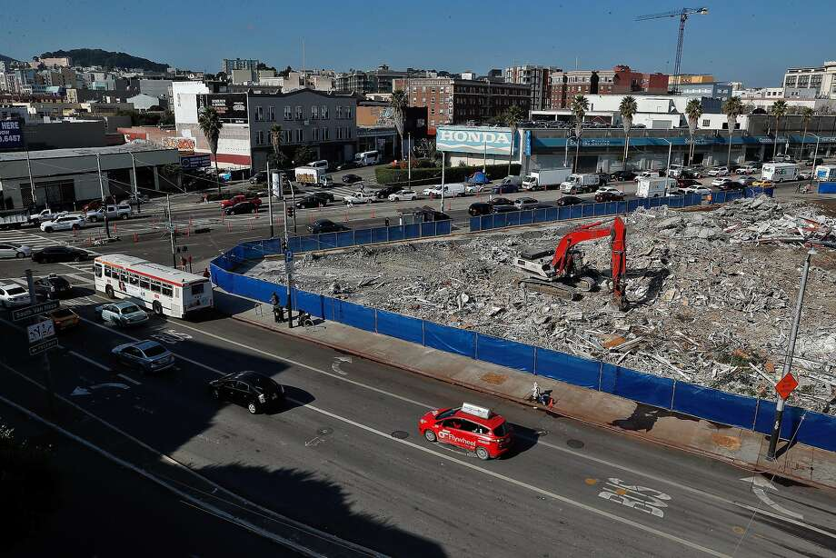 Workers remove the demolition debris of the former Goodwill building at South Van Ness Avenue and Mission Street. Photo: Carlos Avila Gonzalez, The Chronicle