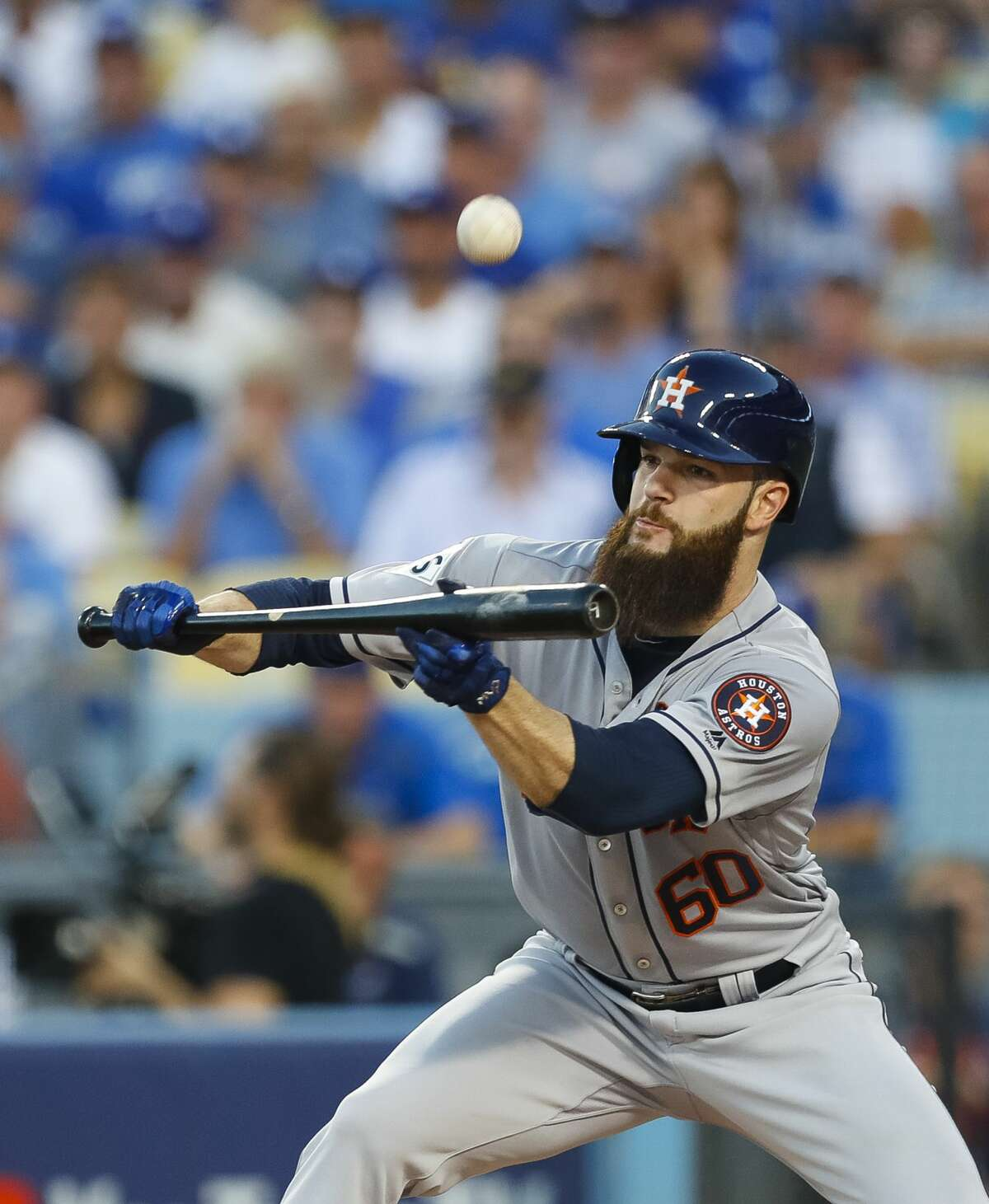 Houston Astros starting pitcher Dallas Keuchel (60) attempts a bunt during the third inning of Game 1 of the World Series at Dodger Stadium on Tuesday, Oct. 24, 2017, in Los Angeles.