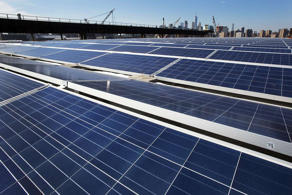 FILE - In this Feb. 14, 2017, file photo, a rooftop is covered with solar panels at the Brooklyn Navy Yard, Tuesday, Feb. 14, 2017, in New York. A U.S. trade commission is recommending that the Trump administration impose tariffs of up to 35 percent to slow an influx of low-cost solar panels imported from China and other countries. (AP Photo/Mark Lennihan, File)
