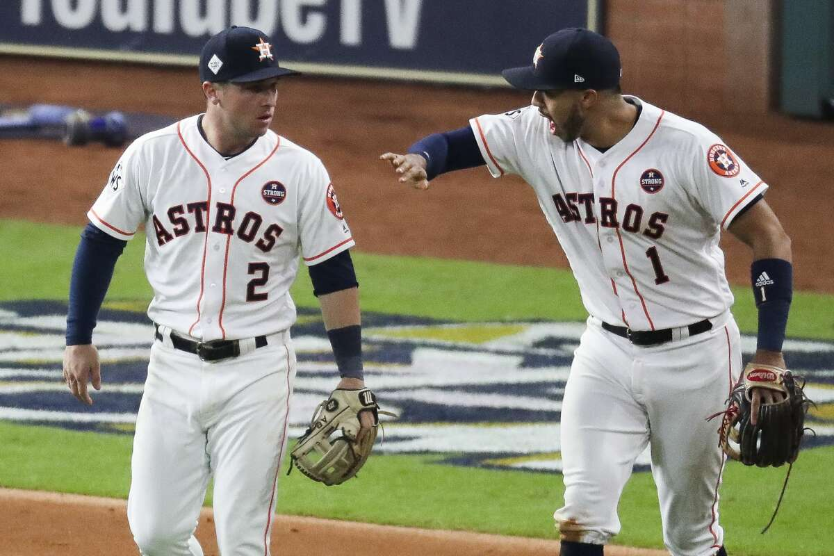 Houston Astros shortstop Carlos Correa (1), right, celebrates third baseman Alex Bregman's (2) throw that prevented a run during the sixth inning as the Houston Astros take on the Los Angeles Dodgers in Game 4 of the World Series at Minute Maid Park Saturday, Oct. 28, 2017 in Houston.