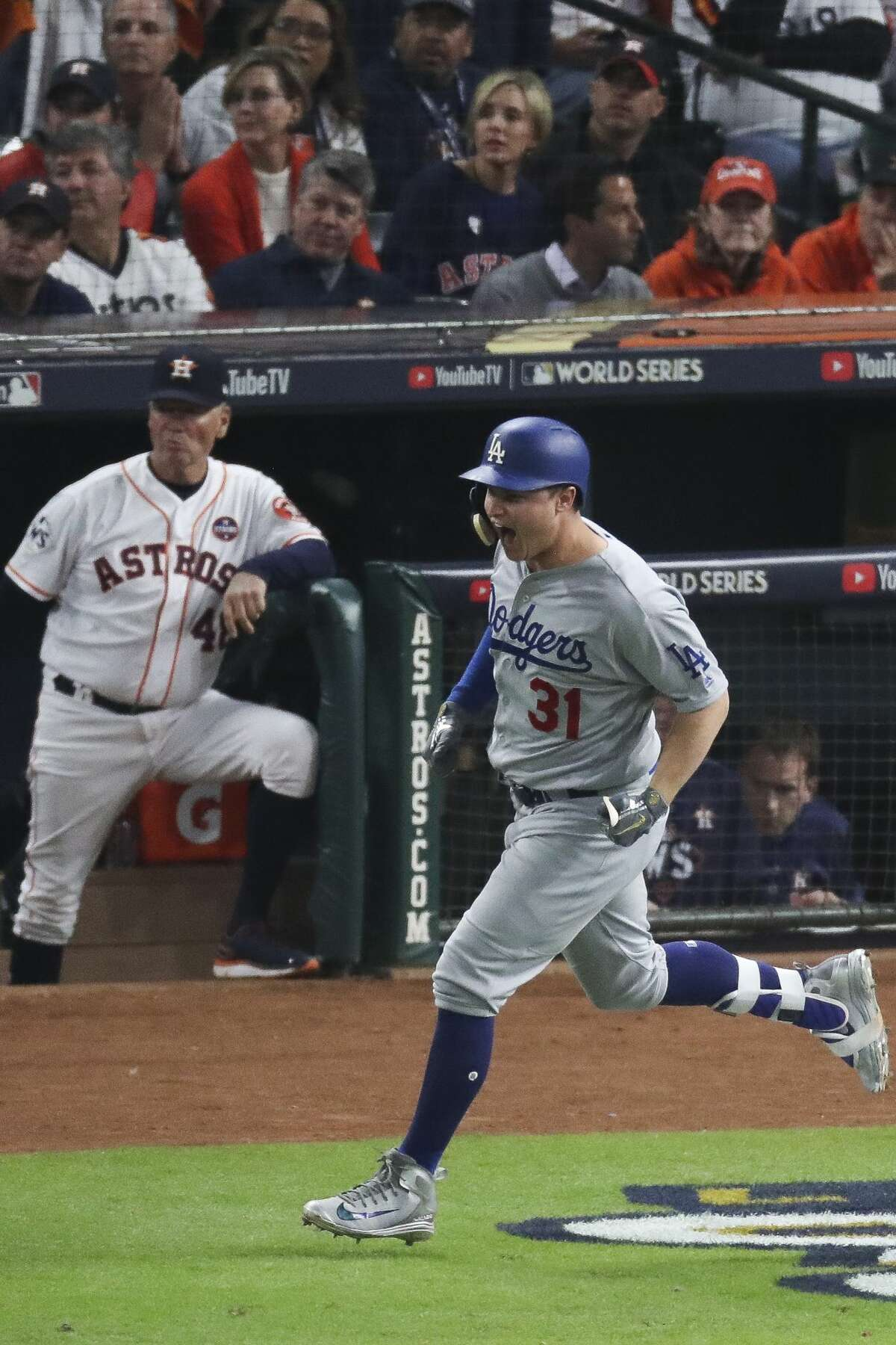 Los Angeles Dodgers center fielder Joc Pederson (31) hits a three-run home run during the ninth inning as the Houston Astros lose to the Los Angeles Dodgers 6-2 in Game 4 of the World Series at Minute Maid Park Saturday, Oct. 28, 2017 in Houston.