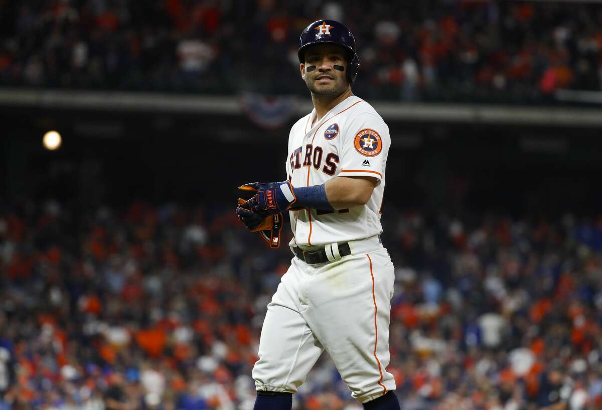 Houston Astros second baseman Jose Altuve (27) walks back to the dugout after flying out to end the ninth inning of Game 4 of the World Series at Minute Maid Park on Saturday, Oct. 28, 2017, in Houston.