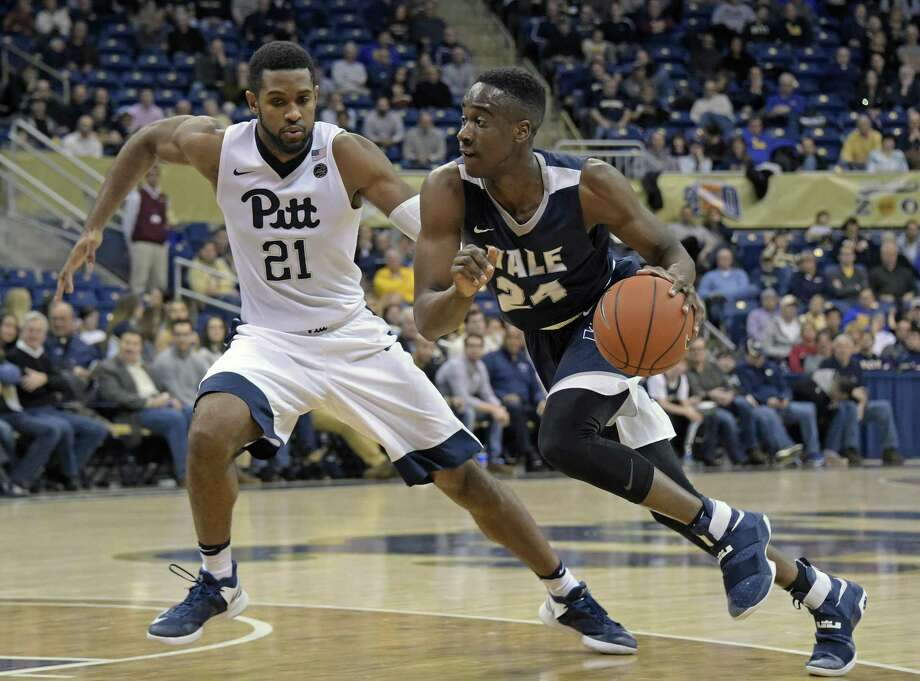 Yale guard Miye Oni (24) drives around Pittsburgh forward Sheldon Jeter (21) last season. Photo: File Photo - The Associated Press / AP / FR171330 AP