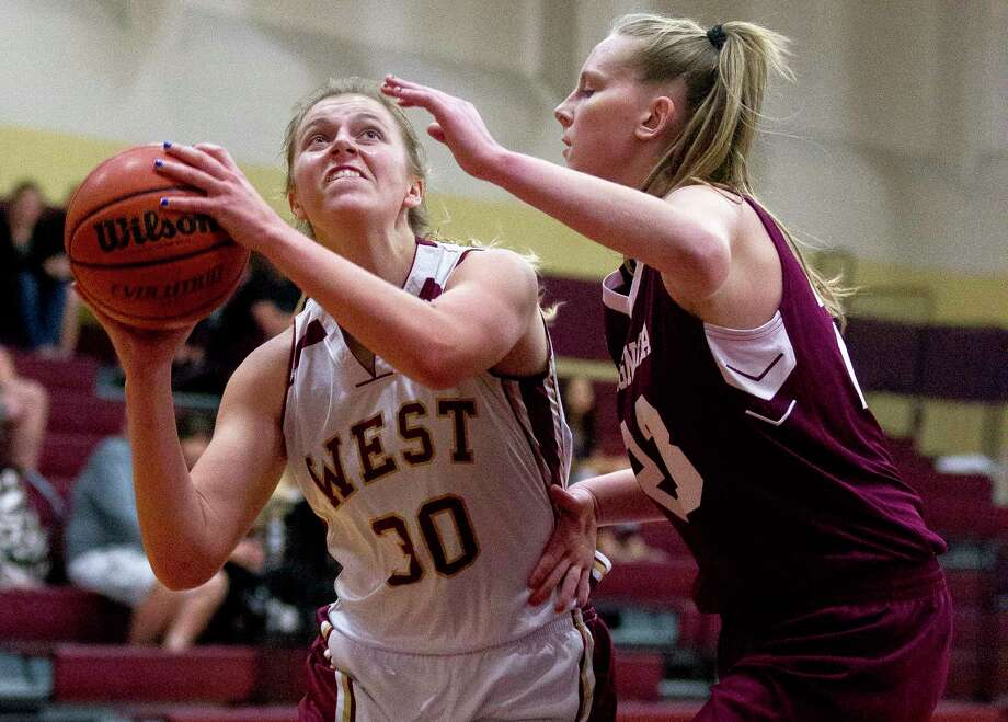 Magnolia West power forward Hannah Eggleston (30) shoots under pressure from Magnolia forward Alexus Wykoff (23) during the first quarter of a District 20-5A high school girls basketball game at Magnolia West High School Tuesday, Jan. 3, 2017, in Magnolia. Magnolia defeated Magnolia West 62-48. Photo: Jason Fochtman, Staff Photographer / © 2017 Houston Chronicle