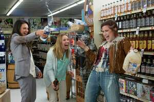 """This image released by STX Productions shows, from left, Mila Kunis, Kristen Bell and Kathryn Hahn in a scene from, """"Bad Moms."""" The movie opens in U.S. theaters on July 29, 2016. (Michele K. Short/STX Productions via AP) ORG XMIT: CAET705"""