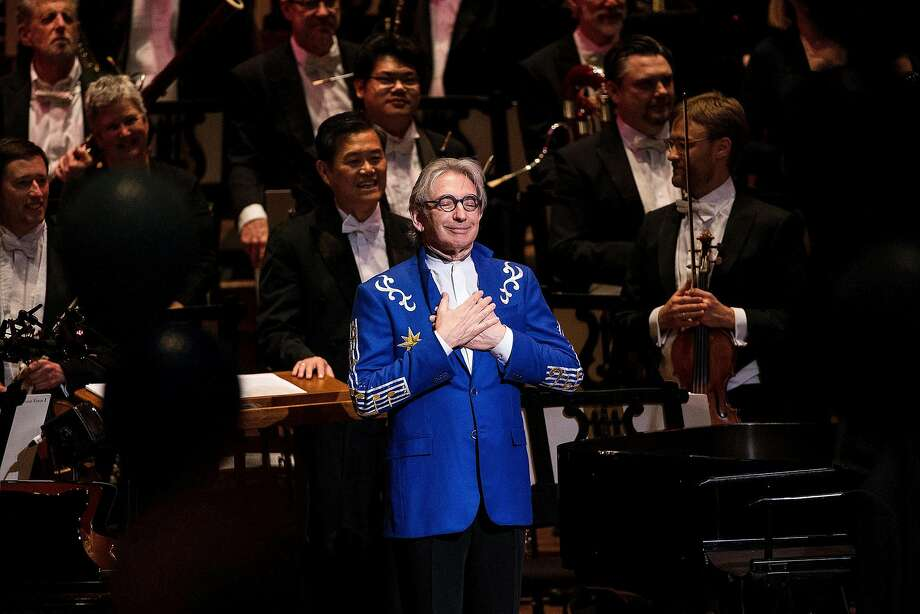 "Michael Tilson Thomas, music director of the San Francisco Symphony, center, reacts as the audience sung ""Happy Birthday"" during his 70th Birthday Gala celebration at Louise M. Davies Symphony Hall in San Francisco, Calif. on Thursday, Jan. 15, 2015. Photo: Stephen Lam, Special To The Chronicle"