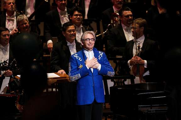 "Michael Tilson Thomas, music director of the San Francisco Symphony, center, reacts as the audience sung ""Happy Birthday"" during his 70th Birthday Gala celebration at Louise M. Davies Symphony Hall in San Francisco, Calif. on Thursday, Jan. 15, 2015."