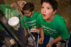 Students at Benbrook Elementary in Houston ISD, a CASE for Kids afterschool program hard-hit by Harvey, trick-or-treat and visit stations at the Children's Museum of Houston.