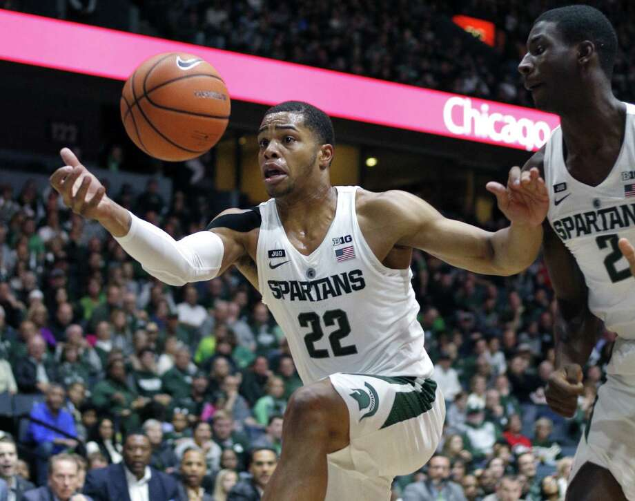 Michigan State's Miles Bridges (22) pulls in the ball as Jaren Jackson Jr. (2) watches during the first half of an exhibition game against Georgia on Oct. 29. Photo: Al Goldis / Associated Press / FR11125 AP
