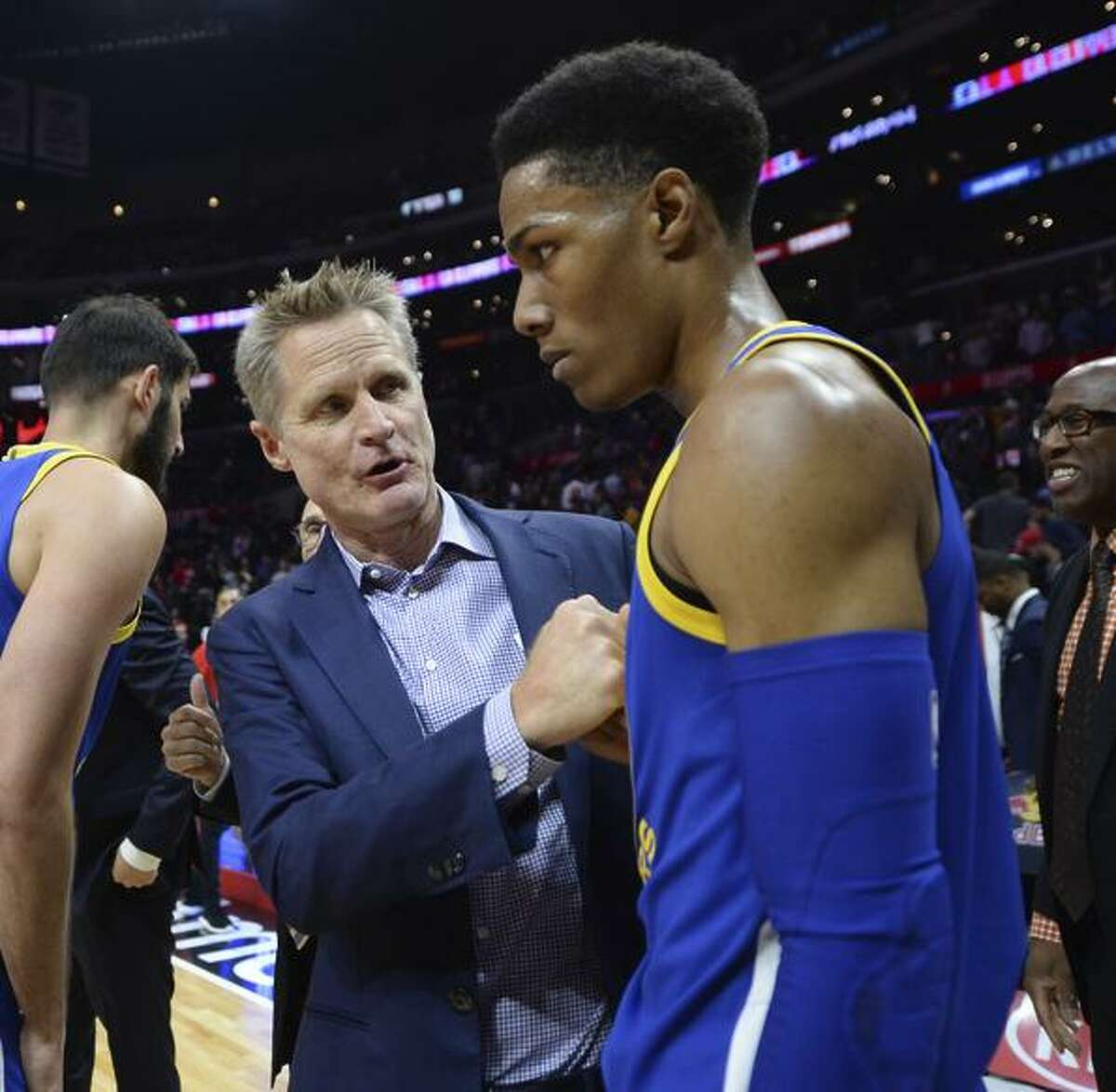 Steve Kerr talks with guard Patrick McCaw after the Warriors' win Monday.