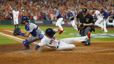 Houston Astros pinch runner Derek Fisher (21) comes home on a Alex Bregman walk off single to give the Astros a 13-12 win over the Los Angeles Dodgers in the tenth inning of Game 5 of the World Series at Minute Maid Park on Monday, Oct. 30, 2017, in Houston.