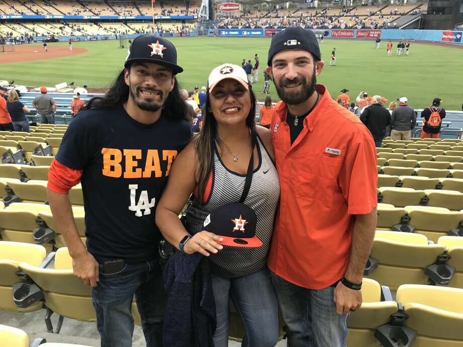 PHOTOS: A look at Astros fans in Dodger Stadium for Game 6 of the World SeriesMark Mendez, Leticia Robles and Patrick Curry flew into Los Angeles from Houston to watch the Astros play the Dodgers in Game 6.Browse through the photos above for a look at Astros fans inside Dodger Stadium for Game 6 of the World Series. Photo: Matt Young