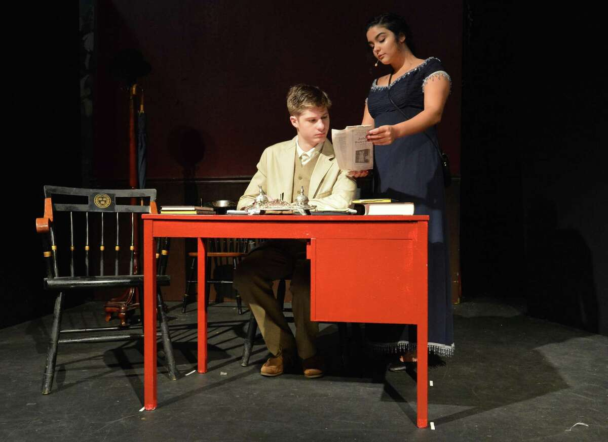 Riley Sexton as Robin Brennan and Cathy Colmenares as Kate Sullivan during a scene from 'Whistleville' , on Sunday October 29, 2017 in Norwalk Conn. Whistleville is a historical musical about South Norwalk that is performed by theater students at The Crystal Theater and opens this Saturday.