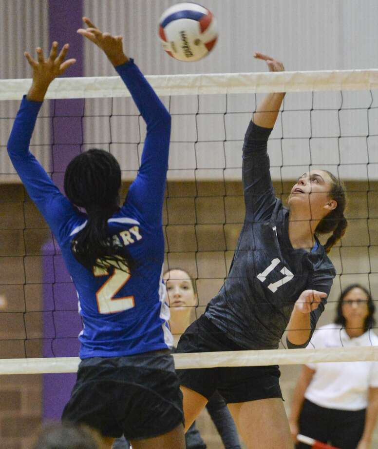 Midland Classical's Jenny Coco hits the ball as Fort Worth Cavalry's Johanna Martin tries to block her 10/31/17  in a TAPPS 3A area playoff at MCA gym. Tim Fischer/Reporter-Telegram Photo: Tim Fischer/Midland Reporter-Telegram