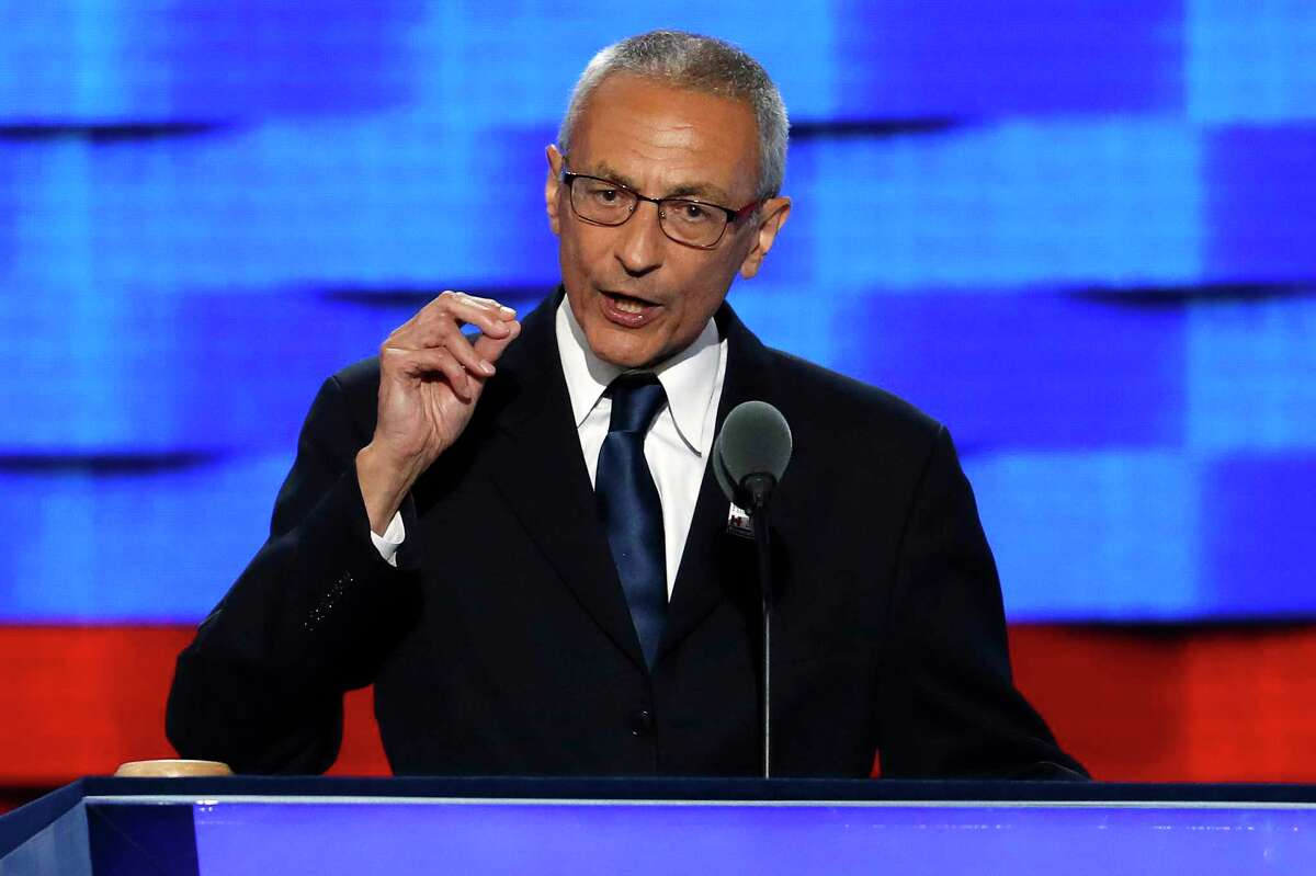 FILE - In this July 25, 2016, file photo, John Podesta, Clinton campaign chairman, speaks during the first day of the Democratic National Convention in Philadelphia. The indictment that alleges covert foreign lobbying by two former Trump campaign officials is casting shadows on three powerful Washington lobbying and legal firms, with Democratic as well as Republican ties, broadening the stakes of the Russia investigation to both parties and drawing in Tony Podesta, the brother of Hillary ClintonÂ?'s campaign chairman. (AP Photo/J. Scott Applewhite, File)