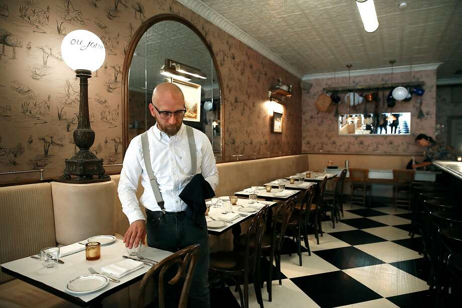 Tables being set at Petit Marlowe, a wine bar in SoMa. Photo: Liz Hafalia, The Chronicle