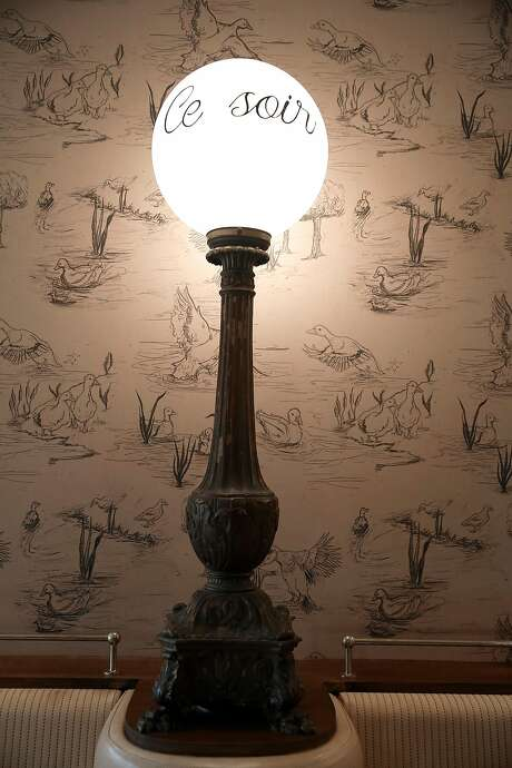 Wall paper and light fixtures at Petit Marlowe. Photo: Liz Hafalia, The Chronicle