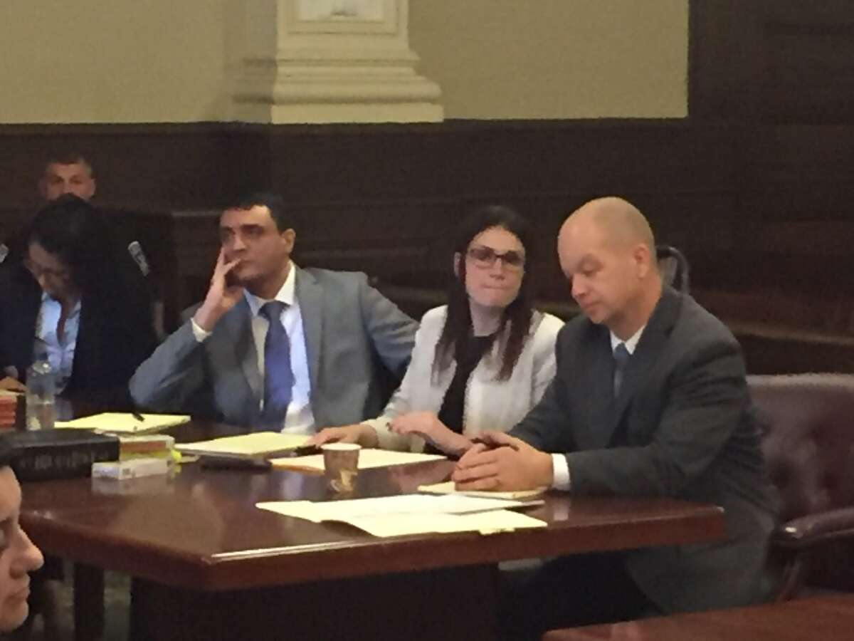 Johnny Oquendo, left, appears in court Tuesday with his lawyers. (Robert Gavin / Times Union)