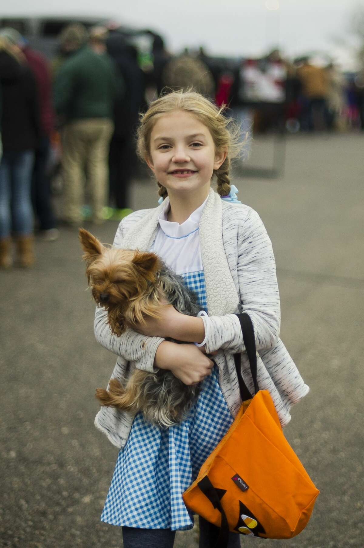 Hayley Schwanda, 10, dressed as Dorothy from the Wizard of Oz, collects candy during Trunk-N-Treat at Messiah Lutheran Church on Tuesday, Oct. 31, 2017 in Midland. (Katy Kildee/kkildee@mdn.net)