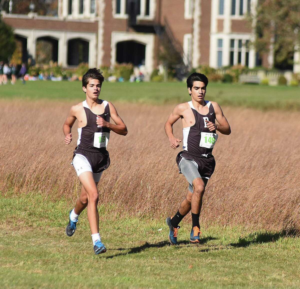 Brunswick runners Kyle Raker, left, and Andres Jasson race at Waveny Park in New Canaan on Tuesday during the FAA boys varsity cross country championship race. Jasson was among 3 Connecticut soccer players chosen to take part in NYCFC's preseason.
