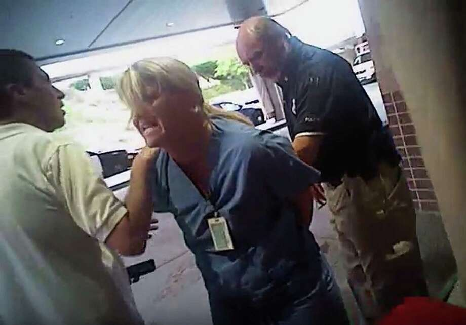 FILE - In this July 26, 2017, frame grab from video taken from a police body camera and provided by attorney Karra Porter, nurse Alex Wubbels is arrested by a Salt Lake City police officer at University Hospital in Salt Lake City. Wubbels, who was arrested for refusing to let a police officer draw blood from an unconscious patient said Tuesday, Oct. 31, 2017, that she was settling with Salt Lake City and the university that runs the hospital for $500,000. (Salt Lake City Police Department/Courtesy of Karra Porter via AP, File) Photo: HOGP / Salt Lake City Police Department via Karra Porter