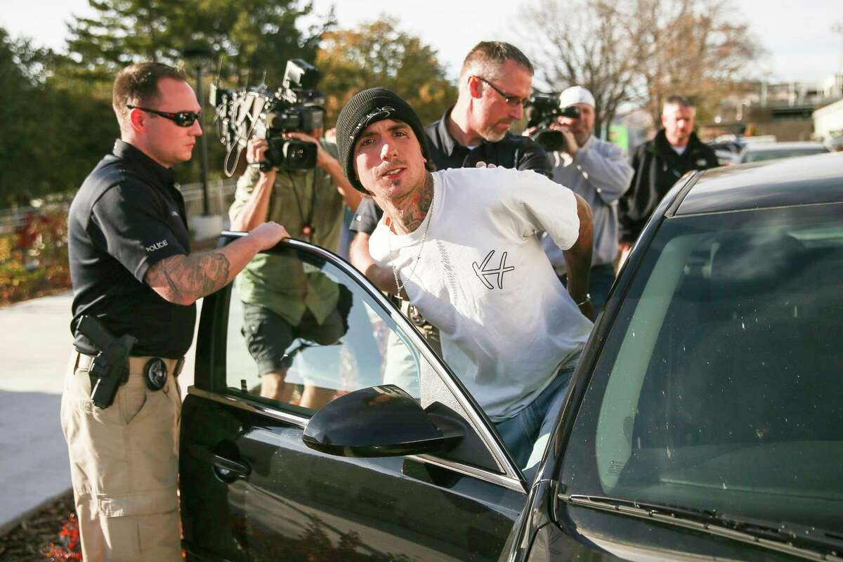 Austin Boutain surrendered to police in Salt Lake City on Tuesday after a manhunt in the foothills near the University of Utah.