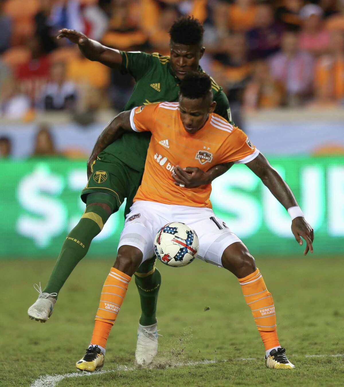 Neither team would give an inch in the first leg of the aggregate Monday night, with the Dynamo's Romell Quioto, right, and the Timbers' Dairon Asprilla effectively tying each other up.