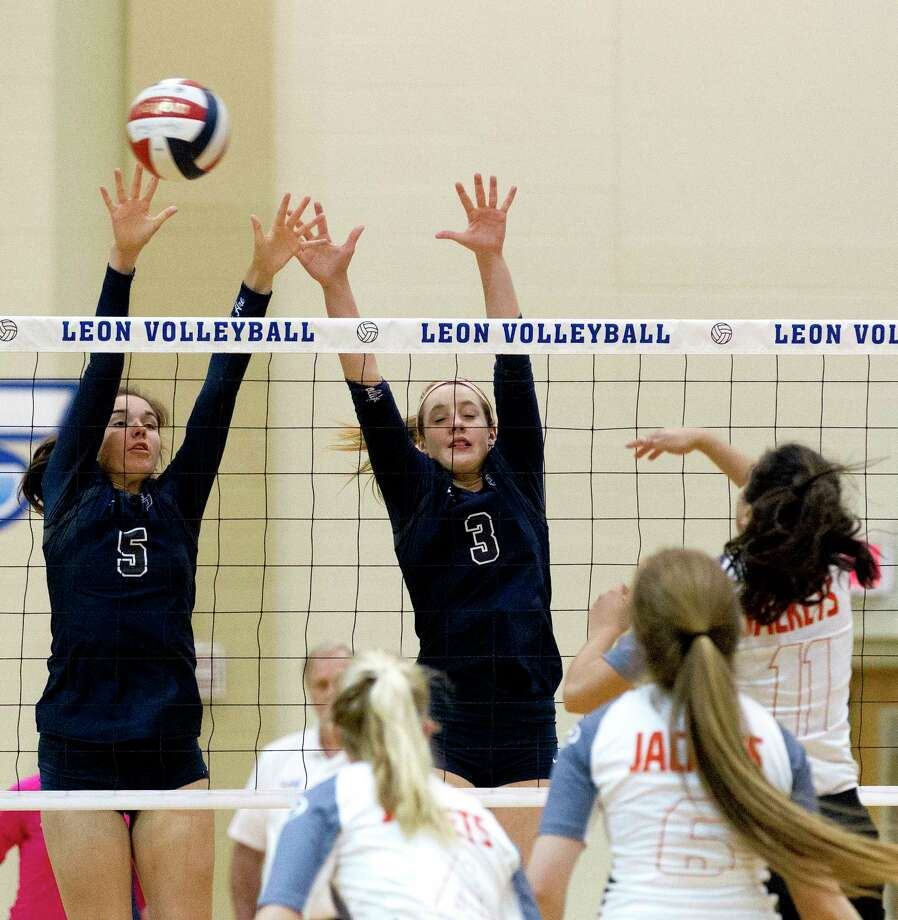 College Park middle hitter Abby Kremer (5) and outside hitter Lauren Freeman (3) challenge a shot by Rockwall outside hitter Victoria Garza (11) during the first set of a Region II-6A bi-district volleyball match at Leon High School, Tuesday, Oct. 31, 2017, in Jewett. Photo: Jason Fochtman, Staff Photographer / © 2017 Houston Chronicle