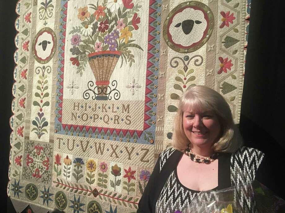 "Janet Stone of Overland, Kan., won the Handi Quilter Best of Show Award at the 2017 International Quilt Festival Houston. Her quilt, ""Garden Variety Sampler"" won $12,500. Photo: Diane Cowen / Houston Chronicle"