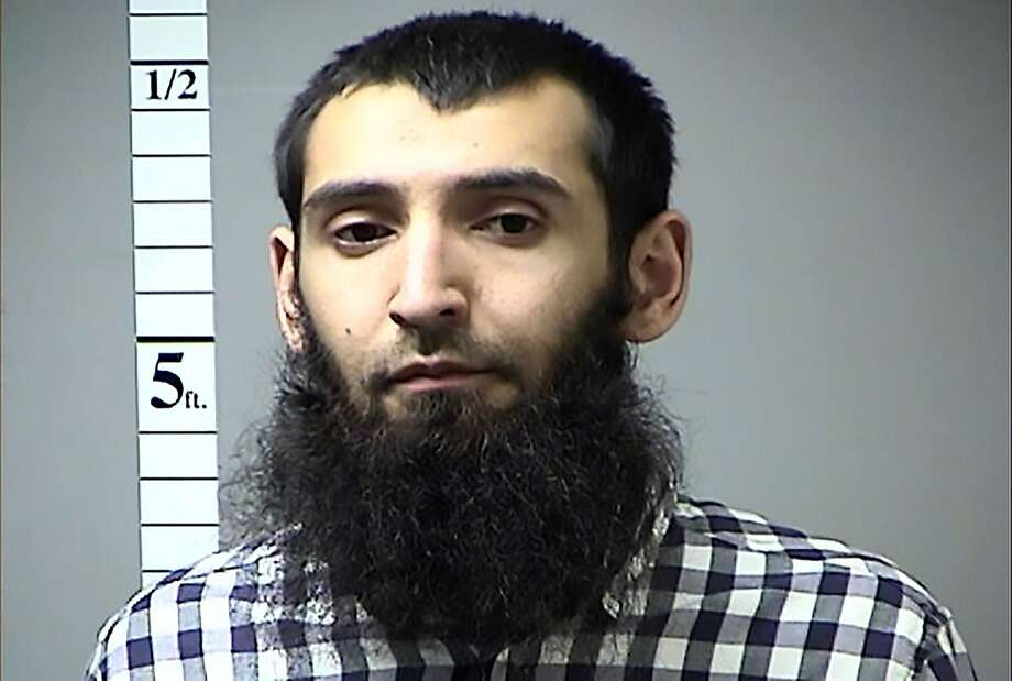 "This handout photograph obtained courtesy of the St. Charles County Police Department on October 31, 2017 shows Saifullah Saipov, the suspected driver who killed eight people in New York on October 31, 2017, mowing down cyclists and pedestrians, before striking a school bus in what officials branded a ""cowardly act of terror.""   Eleven others were seriously injured in the broad daylight assault and first deadly terror-related attack in America's financial and entertainment capital since the September 11, 2001 Al-Qaeda hijackings brought down the Twin Towers. In April of 2016 a warrant was issued in Missouri for his failure to pay a traffic citation.  Photo: ST. CHARLES COUNTY POLICE DEPART, AFP/Getty Images"