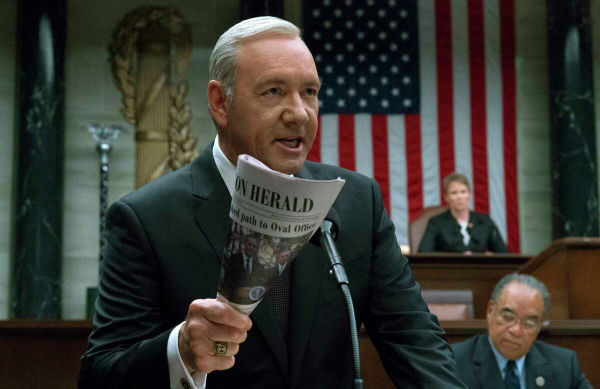 """This image released by Netflix shows Kevin Spacey in a scene from """"House Of Cards."""" Netflix says it's suspending production on """"House of Cards"""" following harassment allegations against Spacey. (David Giesbrecht/Netflix via AP) ORG XMIT: NYET205"""