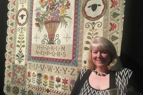 "Janet Stone of Overland, Kan., won the Handi Quilter Best of Show Award at the 2017 International Quilt Festival Houston. Her quilt, ""Garden Variety Sampler"" won $12,500."