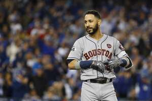 Houston Astros left fielder Marwin Gonzalez (9) reacts after lining out to end the top of the sixth inning of Game 6 of the World Series at Dodger Stadium on Tuesday, Oct. 31, 2017, in Los Angeles.