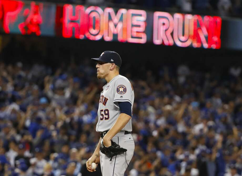Houston Astros relief pitcher Joe Musgrove (59) reacts after surrendering a home run to Los Angeles Dodgers center fielder Joc Pederson (31) during the seventh inning of Game 6 of the World Series at Dodger Stadium on Tuesday, Oct. 31, 2017, in Los Angeles. Photo: Karen Warren/Houston Chronicle