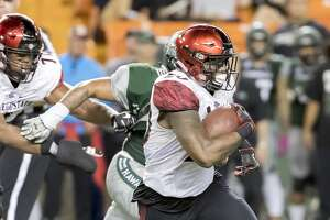 San Diego State running back Rashaad Penny (20) runs with the football in the fourth quarter of an NCAA college football game, Saturday, Oct. 28, 2017, in Honolulu. San Diego State beat Hawaii 28-7. (AP Photo/Eugene Tanner)