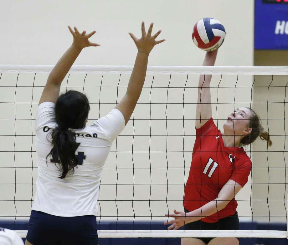 New Braunfels Canyon's Hannah Berry (11) attempts a hit against O'Connor's Gabby DeLosSantos (14) during their Class 6A bi-district volleyball match at Alamo Convocation Center on Tuesday, Oct. 31, 2017. O'Connor defeated New Braunfels Canyon, 3-1, to move on toward state. (Kin Man Hui/San Antonio Express-News) Photo: Kin Man Hui, Staff / San Antonio Express-News / ©2017 San Antonio Express-News