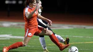 Jamesville-DeWitt's Lainey Foti (9) and Scotia's Tanya Leggiero (7) battle for the ball during a girls' Class A state regional high school soccer game in Stillwater, N.Y., Tuesday, Oct. 31, 2017. (Hans Pennink / Special to the Times Union) ORG XMIT: HP101